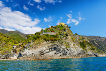 Liguria, Italy coastline of Riviera with colorful houses on sunny warm day. Monterosso al Mare, Vernazza, Corniglia, Manarola and Riomaggiore, Cinque Terre National Park UNESCO World Heritage