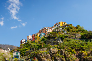 Corniglia, Liguria, Italy fisherman village, colorful houses on sunny warm day. Monterosso al Mare, Vernazza, Corniglia, Manarola and Riomaggiore, Cinque Terre National Park UNESCO World Heritage