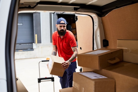 Man loading packages into the car.