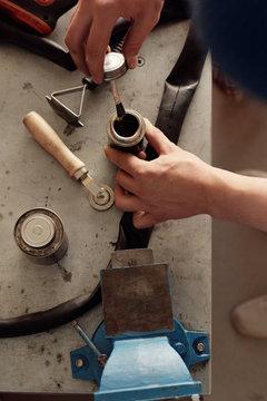 Mechanic Patching Bike Tire