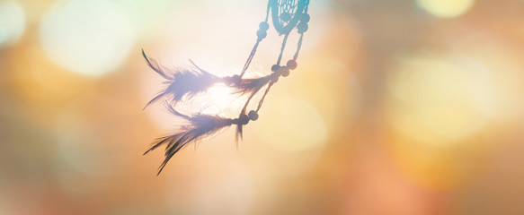 Blurred image, Dream catcher native american in the wind and blurred bright light backgrounds, abstract hope and dream concepts Wall mural