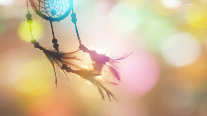 Obraz Blurred image, Dream catcher native american in the wind and blurred bright light backgrounds, abstract hope and dream concepts - fototapety do salonu