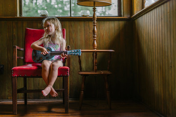 Young Girl Seated with Guitar