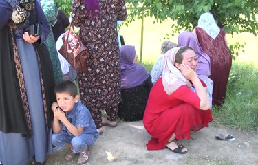 A still image, taken from a video footage, shows relatives of inmates reacting after reports about deadly riots inside a prison in the city of Vakhdat