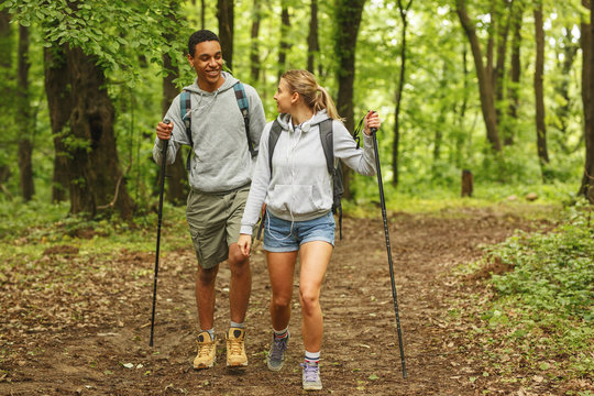 Young couple hiking in nature.They enjoying in walk and fresh air.