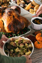 Thanksgiving: Women Placing Various Side Dishes By Roast Turkey