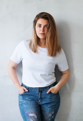 Young beautiful woman in white t-shirt and jeans