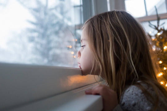 Looking out window on Christmas morning
