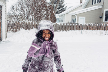 Smiling black girl in the snow
