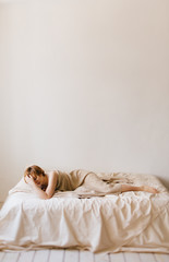 alone woman on the bed