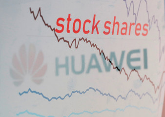 Huawei logo is reflected in a displayed stock graph in this illustration picture