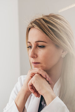 Portrait of pensive doctor woman working at the office