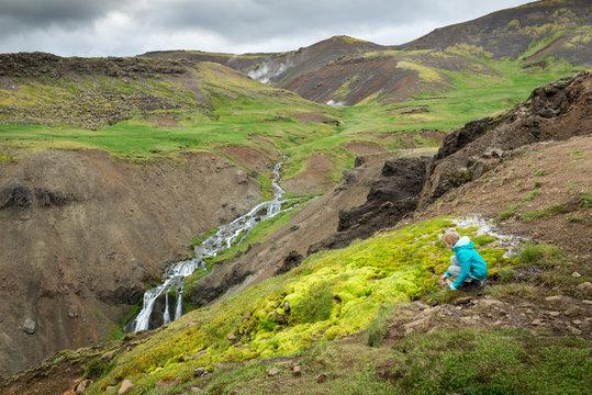 Girl enjoys nature in beautiful Iceland Reykjadalur Valley hot river