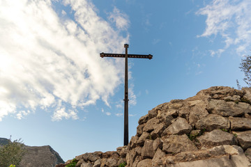 Christian cross on a hill