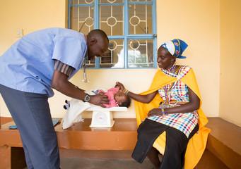 Doctor examining baby.