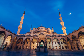 Blue Mosque building at full moon night, Istanbul, Turkey.