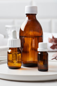 Natural essential oils in different bottles.