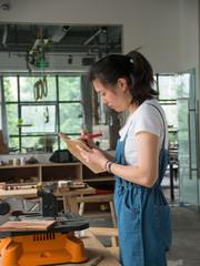 Female Carpenter working in the studio