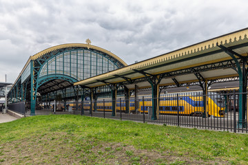 Dutch railway station Den Bosch with historic construction and roof