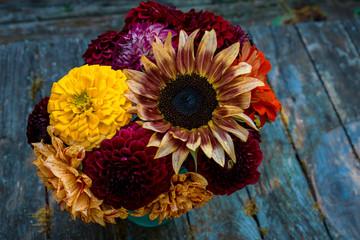 Late summer seasonal bouquet with zinnias, dahlias and sunflowers.