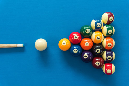 pool or billiards balls on light blue table