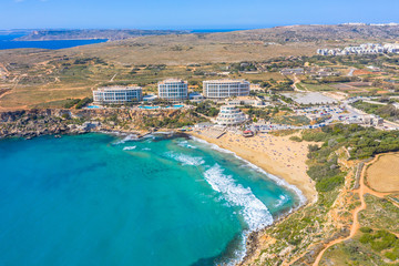 Aerial view of a Golden Bay beach on Tuffieha region, Malta.