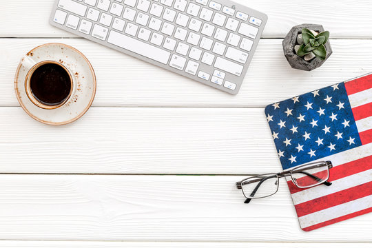 Memoral day of United States of America with flag, keyboard, glasses and coffee on white background top view mockup