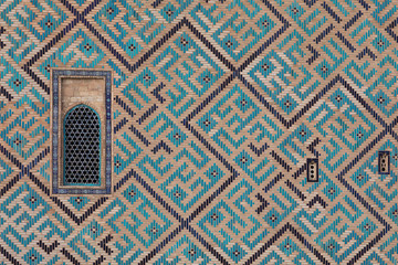 ancient wall of a mosque of mosaic tiles