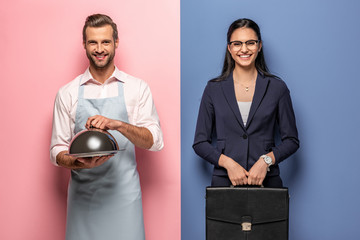 happy man in apron with Serving Tray and businesswoman with briefcase on blue and pink