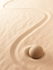 Minimalism zen sand and stone meditation garden. Spa wellness or yoga background with copy space. Concept for purity, spirituality and mindfulness. .