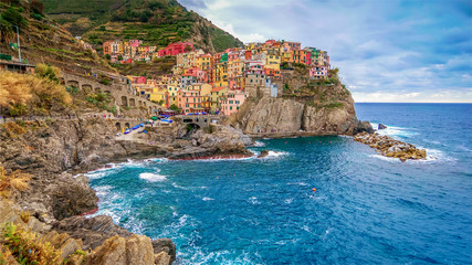 The seaside village of Manarola sits on the famous cliffs of Cinque Terre in La Spezia, Italy Wall mural