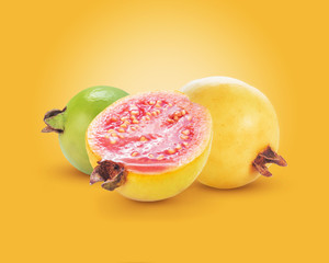 Ripe yellow guava fruit with a sliced piece isolated on yellow background