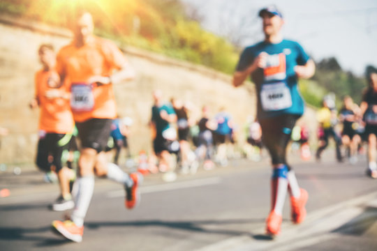 Marathon runners in the city. Blurred marathon background.