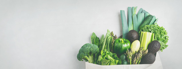 Variety of Fresh Vegetables and greenery in cotton eco bag on concrete background.Zero Waste shopping concept. Long wide banner with copy space. - fototapety na wymiar