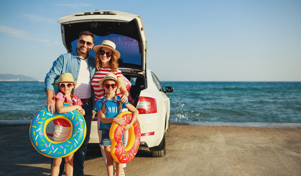 happy   family  in summer auto journey travel by car on beach.