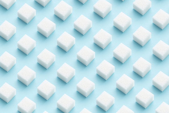 Pattern made of sugar cubes on blue abstract geometry minimal style background