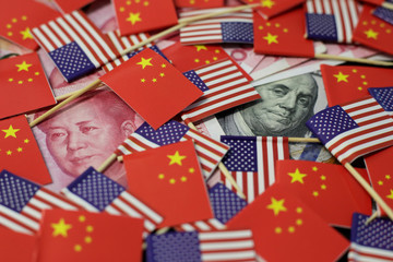 Illustration picture showing U.S. dollar and China's yuan banknotes