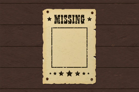 Old missing poster. Western bounty brochure nailed to a wooden wall.