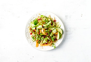 Cucumber, carrot , sugar pea and quinoa salad with pomegranate seeds