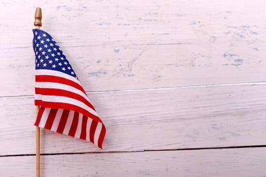American flag on white wooden background with copy space. Memorial Day, 4th of July or Labour Day.