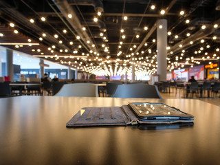 Moscow, Russia - May, 5, 2019: Image in the foreground of a tablet lying on a table in a cafe in the shopping center Salaris in Moscow