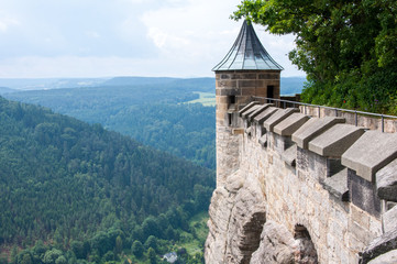 The fortress wall and the tower of an ancient medieval fortress on a cliff above the plains. Wall mural