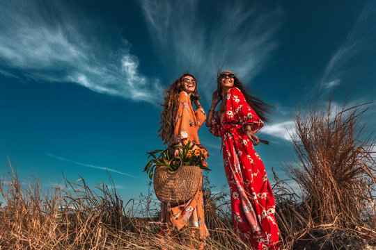 two beautiful stylish boho models outdoors