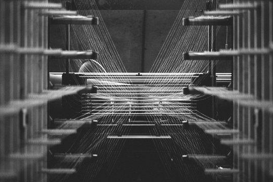 Textile factory machine weaving close up
