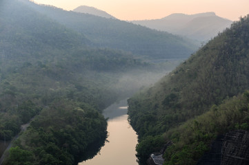 Scenery of river in rainforest valley with foggy
