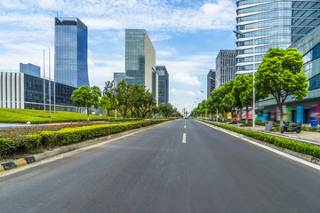 city road through modern buildings in suzhou