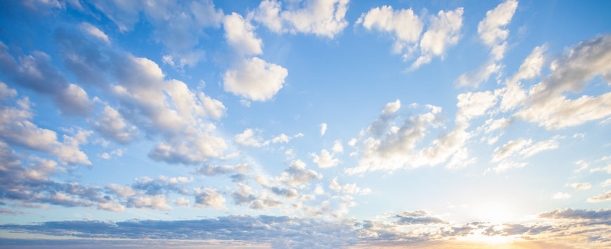 Blue sky clouds background, Beautiful landscape with clouds and orange sun on sky