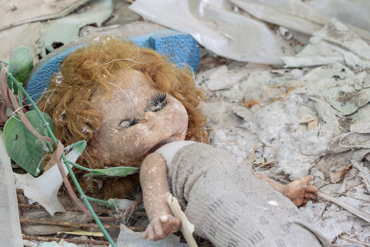 Dirty old doll in an abandoned house in Chernobyl exclusion zone in Belarus