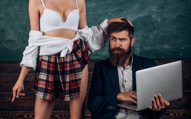 Sex education. Sex role game. Guy laptop erotic video. Man experienced bearded teacher and seductive female sexy boobs. Learning sexy female body. Sexual life concept. Desirable student sexy breasts