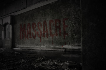 text massacre on the dirty wall in an abandoned ruined house